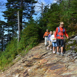 A family hikes in Acadia National Park