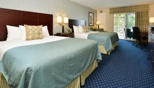 A double queen room in the Atlantic Building at the Atlantic Oceanside Hotel