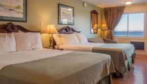 A double queen room in the Oceanside Building at the Atlantic Oceanside Hotel